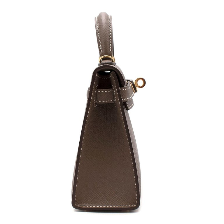Hermes Etoupe Epsom Leather Mini Kelly Sellier II GHW  One of the most desirable and celebrated bag designs in the world the Hermes Kelly was designed in the 1930's. Renamed after Princess Grace of Monaco, it's timeless elegance and minimal style