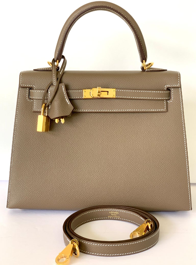 Hermes 25cm Kelly Hermes Kelly 25cm Etoupe one of the most coveted colors, sucha a great neutral for everyday Never worn, plastic on the hardware including shoulder strap hardware One of the hottest bags in the market right now Etoupe Epsom in size