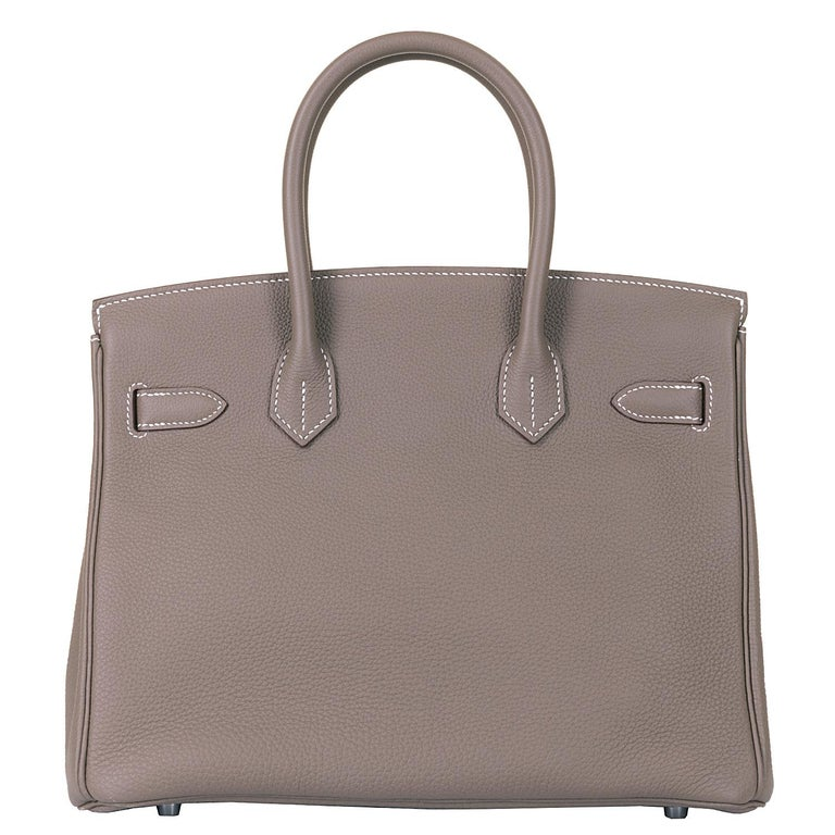 This fabulous Hermes Birkin 30 Bag is finished in 'Etoupe' Togo leather, accented with Palladium hardware. Togo is the most popular Hermes leather for Birkin bags, with its grained textured finish, it is both anti-scratch and lightweight, yet always