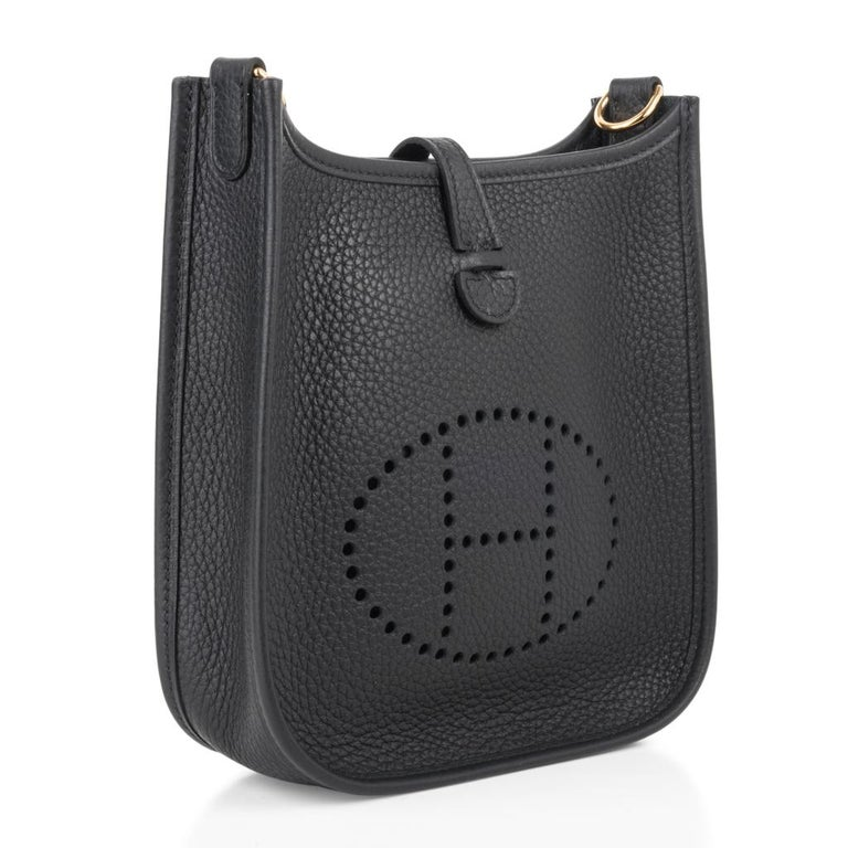 Guaranteed authentic Black Hermes Evelyne TPM bag easily worn as a shoulder or crossbody.   Clemence leather is soft and scratch resistant. Signature perforated H on front of bag. Lush with Gold hardware. Fabulous shoulder or cross body bag.  Sport
