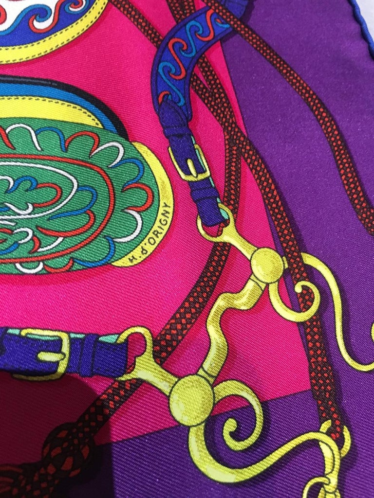 Hermes Festival des Amazones Silk Pocket Square in excellent condition. Original silk screen design c1992 by Henri d'Origny features a colorful assortment of horse saddles in orange, green, blue with yellow and red accents over a fuchsia pink