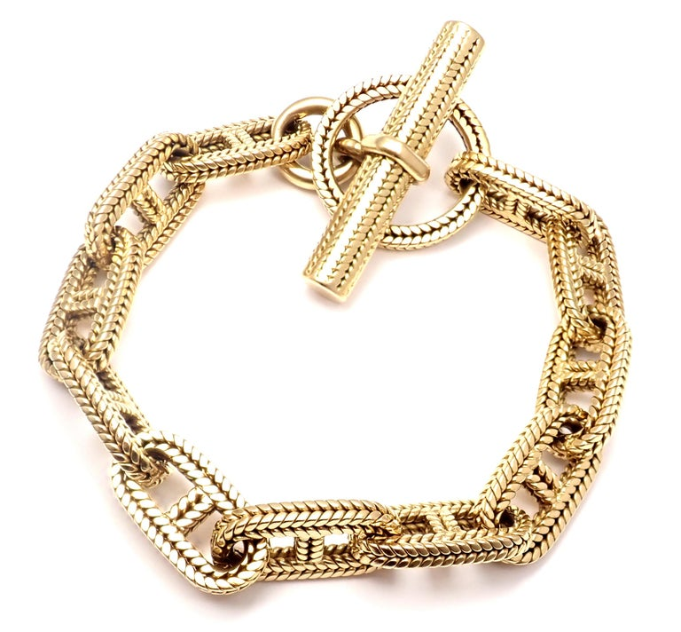 18k Yellow Gold George L'Enfant Chaine d'Ancr Link Toggle Bracelet by Hermes. This bracelet is Circa 1960's Details: Weight: 85.4 grams Length: 8