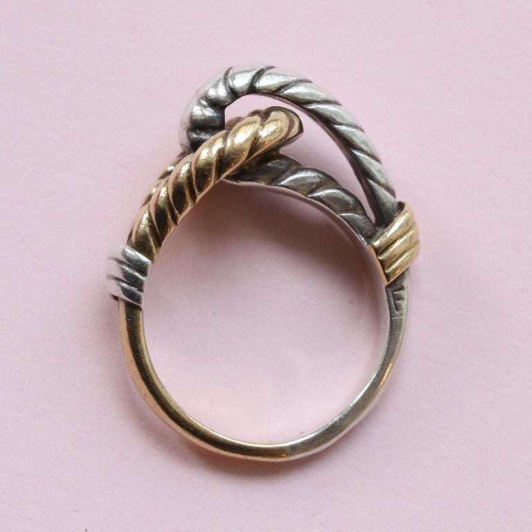 An 18 carat gold and silver knot ring, signed: Hermès, Paris, France.  weight: 6.03 gram ring size: 15 mm. / 7 US.