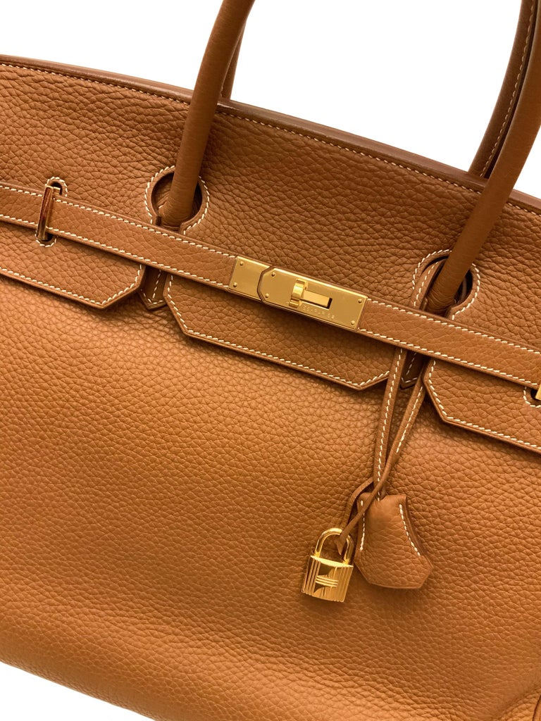 A classic from the house of Hermès, the Birkin 40 in Togo leather. Its gold color mix with light color stitches is a must in the chic look for any occasions !  Although it is from 2011 and pre-owned, it is in fabulous condition !  Year: