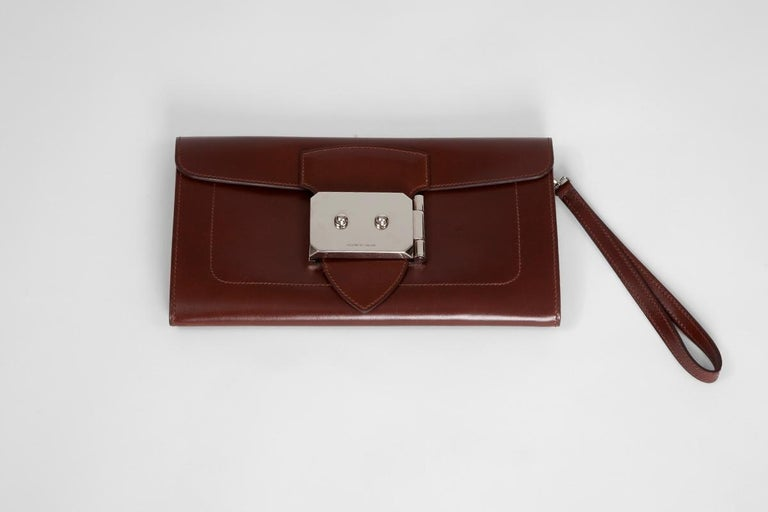 "Hermès ""Goodlock"" clutch in ""noisette"" box calf leather and palladium hardware. Featuring a fold-over top with push-lock closure, this clutch features a main internal compartment along with one side opened pocket. The interior is fully lined in goat"
