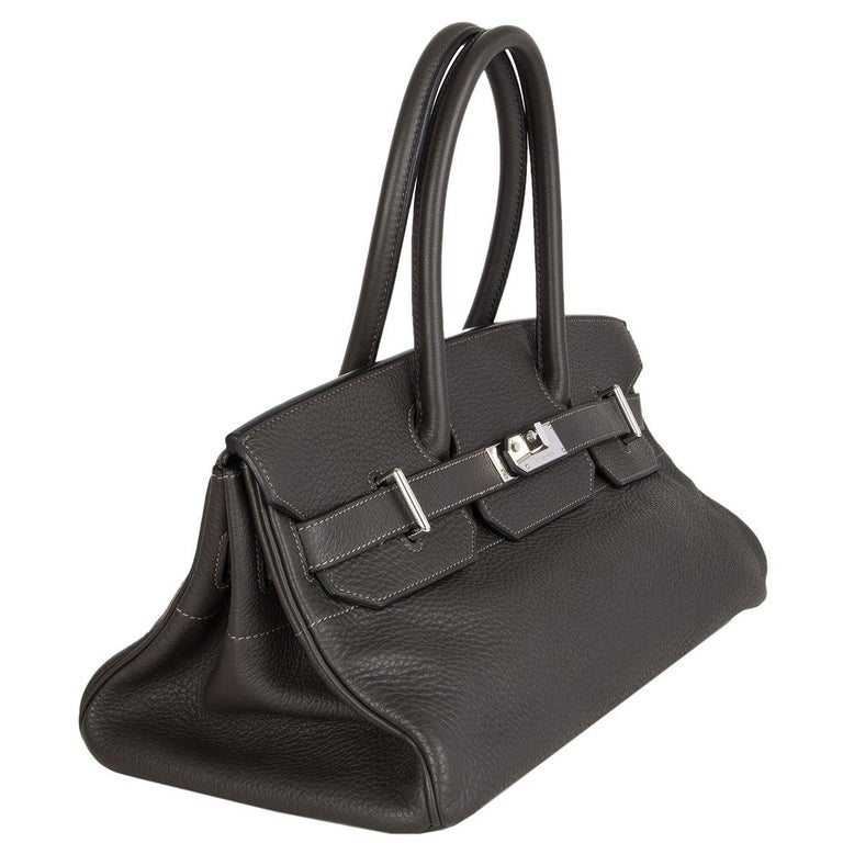 Hermès 'JPG I Shoulder Birkin' bag in Graphite (dark gray) Taurillon Clemence with Palladium hardware. Lined in Chevre (goat skin). Has been carried and is in excellent condition. Comes with lock, key, clochette, dust bag and raincoat.   Height 19cm