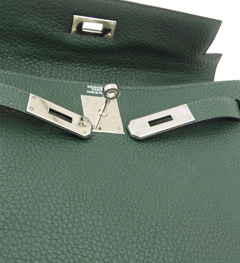 Hermes Red Leather Kelly Palladium Ado Men's Women's Travel Backpack Shoulder Bag  Leather Palladium tone hardware Turnlock closure Leather lining Date code present Made in France Adjustable shoulder strap 17-31