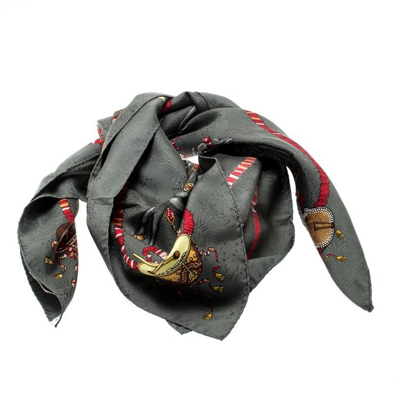 In a mix of signature prints and lovely colours splayed all over, this Hermes scarf is sure to make the best fashion accessory in your closet. It is made from silk and it comes in a square shape.  Includes: The Luxury Closet Packaging