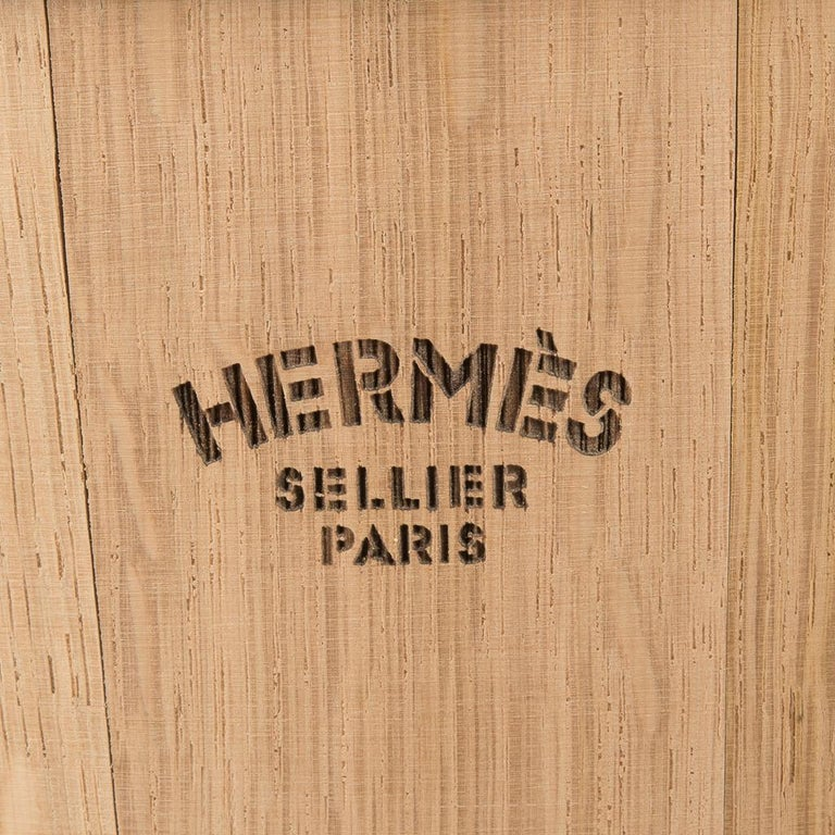 Guaranteed authentic Hermes equestrian grooming stable bucket features oak wood. Cowhide handle with stainless steel ring.  Hermes Sellier Paris signature in  black. This equestrian piece is also a wonderful display piece in the home! New or