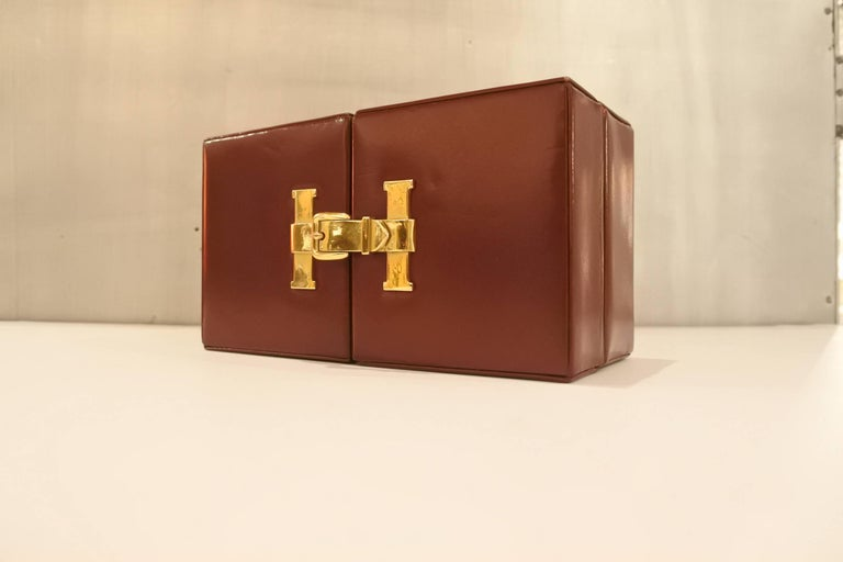From a time when travel was simply not the same. The buttery, ox blood leather on this travel weather station is in impeccable condition. The clock is working, but our favorite part is the jewelry like clasp that opens the belt buckle, exposing the