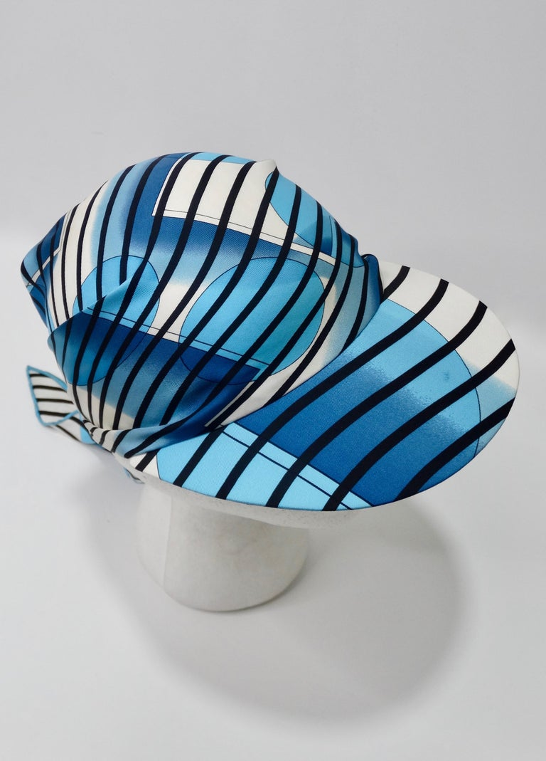 Relax by the beach or pool in style with this adorable Hermes scarf cap! Designed by Bali Barret for Hermes circa 2005, the scarf displays bold black stripes, aqua bubbles and a large H with a