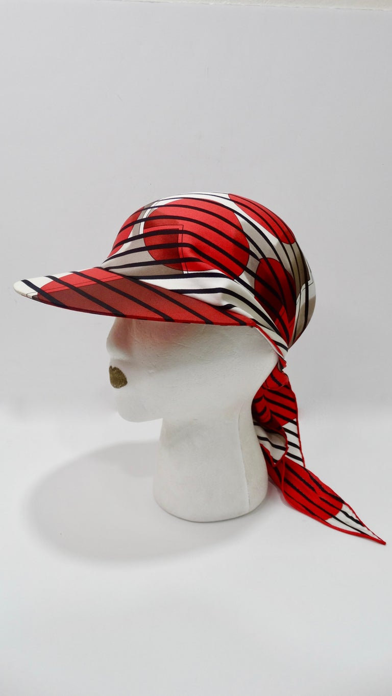 Relax by the beach or pool in style with this adorable Hermes scarf cap! Designed by Bali Barret for Hermes circa 2005, the scarf displays bold black stripes, vibrant red bubbles and a large H with a