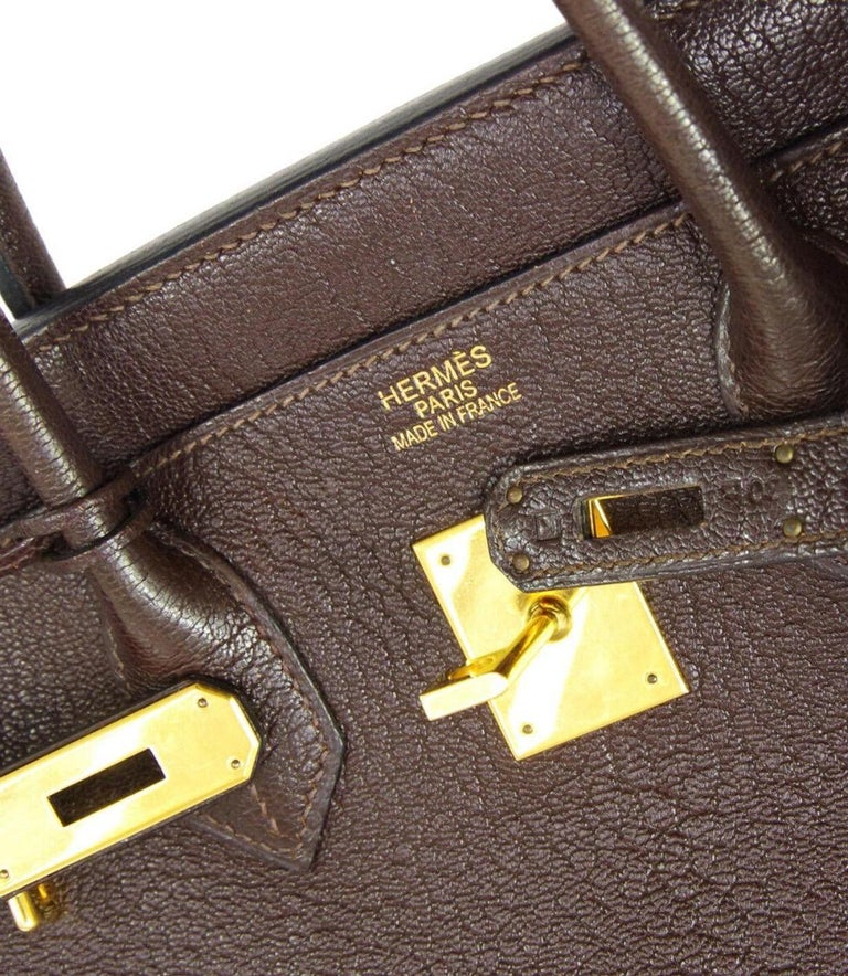 Leather Gold tone hardware Leather lining Date code present Made in France Handle drop 3