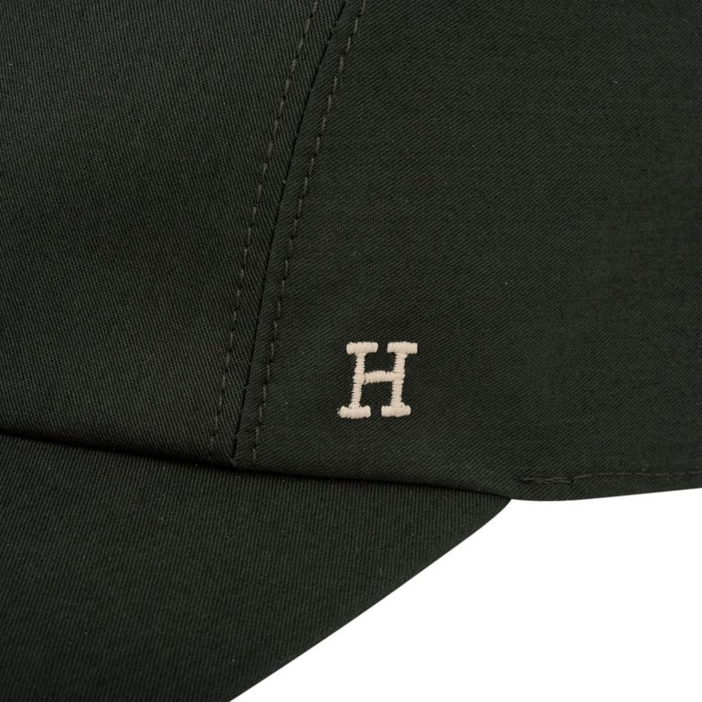 Guaranteed authentic Hermes Nevada cap features Vert Anglais Cotton serge.  Bone H is embroidered on the side.  Clous De Selle snaps at rear.   Comes with Hermes box.   NEW or NEVER WORN  final sale  HAT SIZE: 59    CONDITION: NEW or NEVER WORN