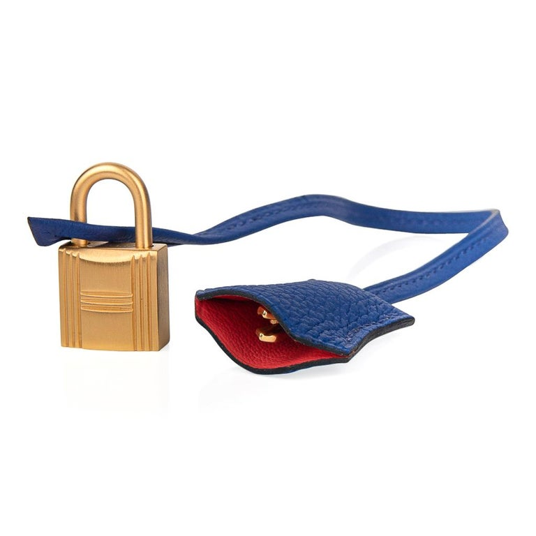 Mightychic offers a guaranteed authentic striking Hermes HSS Birkin 40 bag is featured in Blue Electric. This limited edition special order Hermes birkin bag has Rose Jaipur Pink interior. Accentuated with rare brushed gold hardware.  Comes with