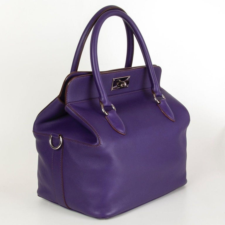 100% authentic Hermes 'Toolbox 26' bag in Iris purple Veau Swift leather with palladium plated hardware. Detachabel and adjustable canvas shoulder strap. Lined in Veau Swift with two open pockets against the front and and open pocket against the