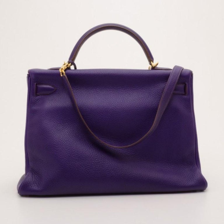 The famous Kelly by Hermes is a handbag that will remain a must-have bag for years to come. This version is crafted from supple Togo leather in purple iris. The classic exterior is detailed with a gold twist lock closure, a leather clochette, double