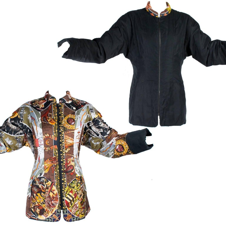 This Hermes jacket is in the Les Mythologies des Hommes Rouges scarf print and can also be worn reversed to a solid black jacket with scarf print trim.  This Hermes reversible coat was made in France and we guarantee the authenticity of all of our