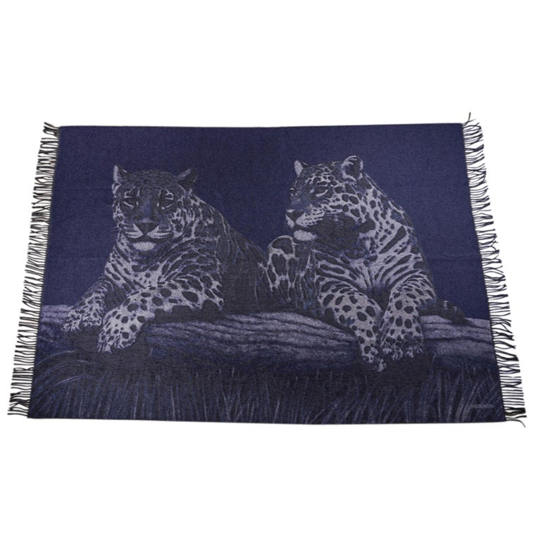 Mightychic offers a guaranteed authentic Hermes Jaguars Du Bresil blanket featured in Blue. Impossibly soft jacquard woven Cashmere with fringed edge. This exquisite Hermes blanket will elevate any room you choose to display it in. Comes with