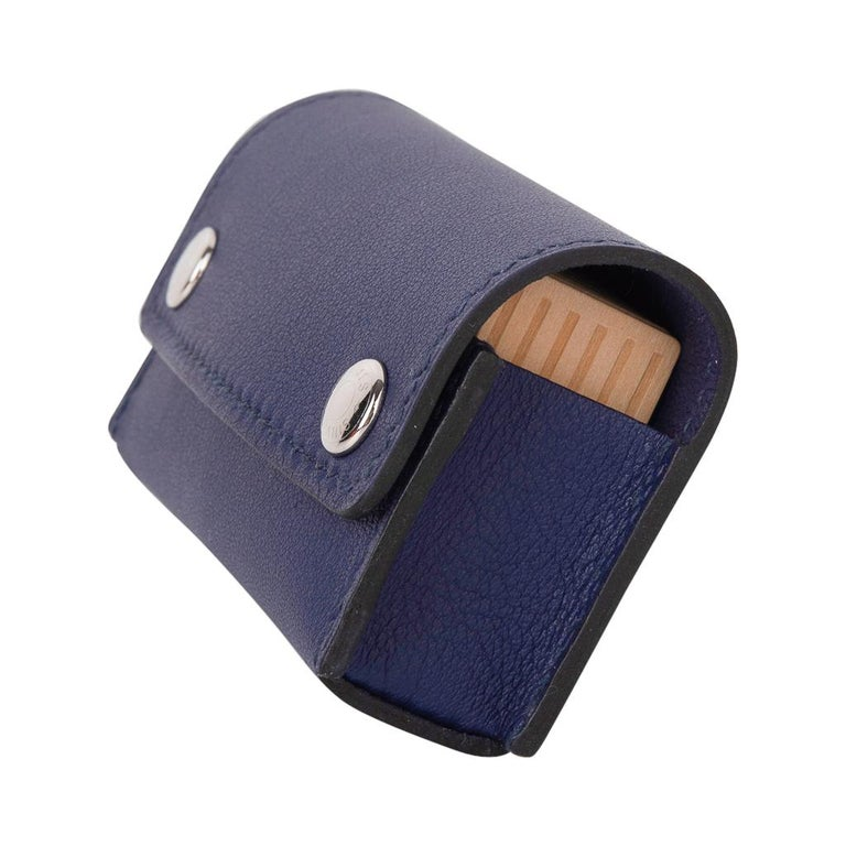 Guaranteed authentic Hermes Dominos in the Pocket In features Bleu Encre Swift leather. Domino tiles are wood with H on one side and dots on the other. Case is Bleu Encre in Swift Leather with Clou de Selle snaps Comes with signature Hermes box.