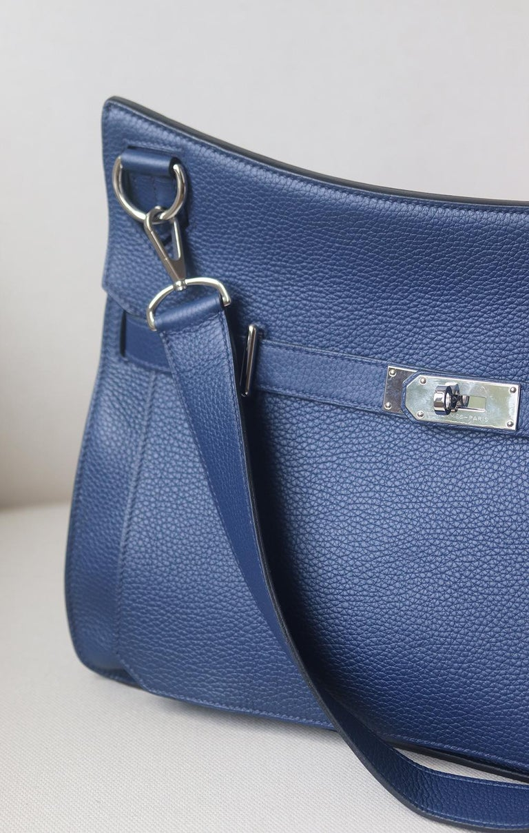 Hermès Jypsière 37cm Togo Leather Bag with Palladium hardware. Detachable and adjustable shoulder strap. Tonal leather lining. Double slit pocket and zip pocket on interior walls. Turn-lock closure at front. Colour: navy. Comes with dustbag. Some