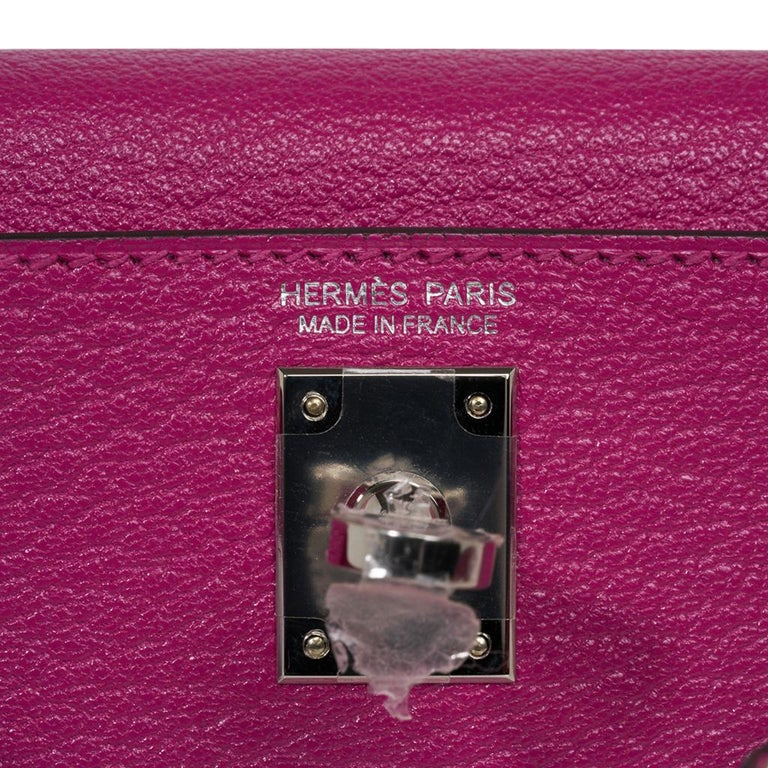 Guaranteed authentic Hermes Kelly 20 Mini Sellier bag featured in rich Rose Pourpre.  Chevre leather accentuated with Palladium hardware. Comes with signature Hermes box, shoulder strap, and sleeper. This bag is also available in Craie, Rose