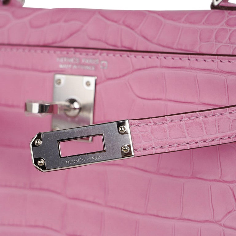 Mightychic offers a guaranteed authentic Limited Edition Hermes Kelly 20 Mini Sellier bag featured  in coveted unircorn 5P Pink matte Alligator. Fresh with palladium hardware. The Kelly 20 bag in alligator is extremely limited and difficult to