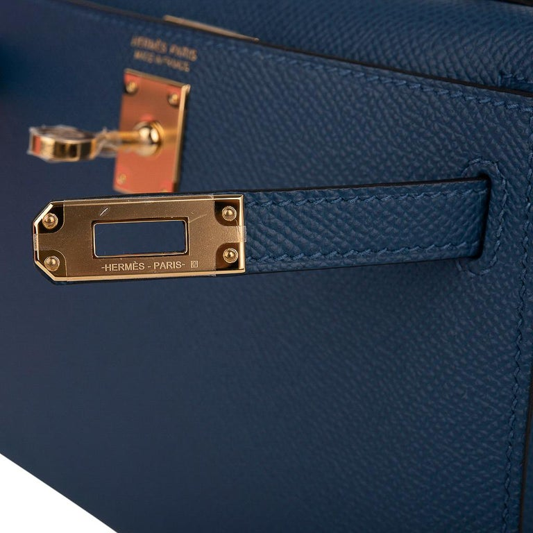 Guaranteed authentic Hermes Kelly 20 Mini Sellier bag featured in rich, saturated Deep Blue.  Epsom leather and accentuated with gold hardware. Carry by hand, shoulder or cross body. The Kelly 20 bag in alligator is extremely limited and difficult