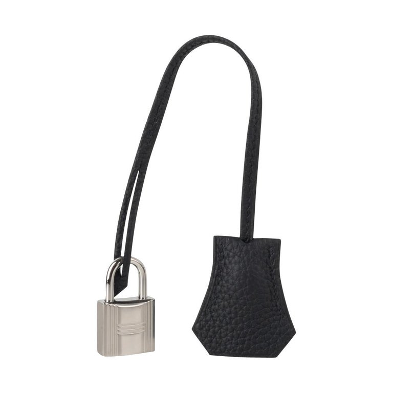 Guaranteed authentic Hermes Kelly 25 retourne bag is featured in classic Black togo leather. Fresh with palladium hardware.  Perfect to carry day to evening.   Comes with signature Hermes box, raincoat, shoulder strap, sleepers, lock, keys and