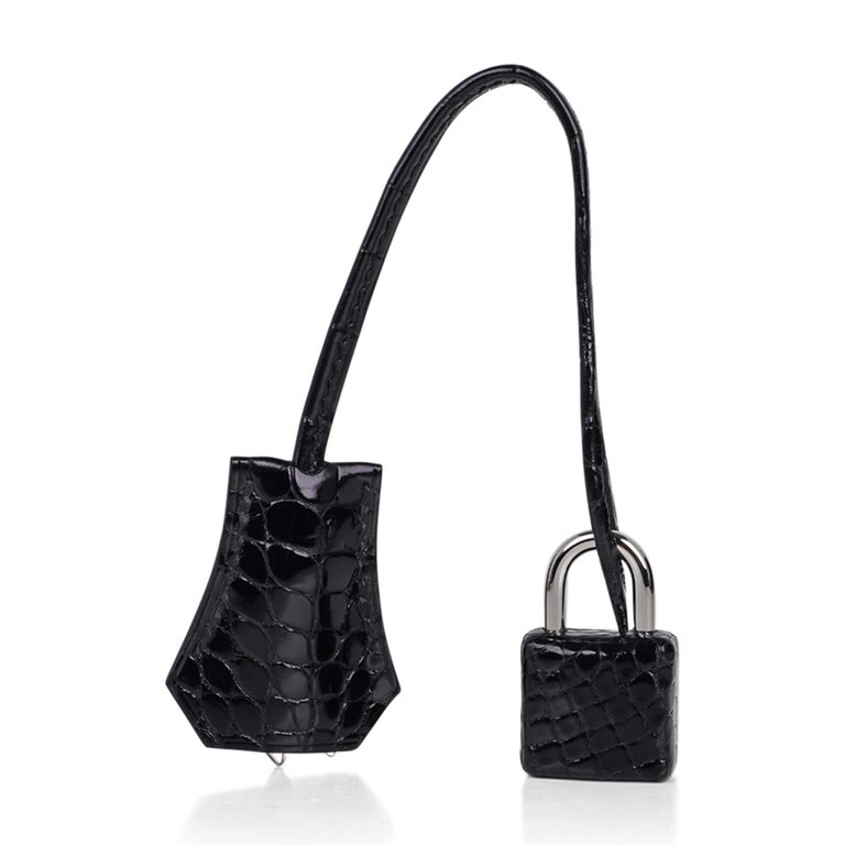 Guaranteed authentic Hermes Kelly 25 Sellier bag featured in Black Alligator.  Stunning Kelly with timless Palladium hardware.  Comes with signature Hermes box, raincoat, shoulder strap, sleepers, lock, keys and clochette.  NEW or NEVER WORN The