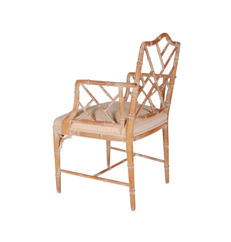 A classic looking Chippendale chair made by McGuire in the 1970s. It features a solid birch frame with white wash finish and upholstered seat cushion.