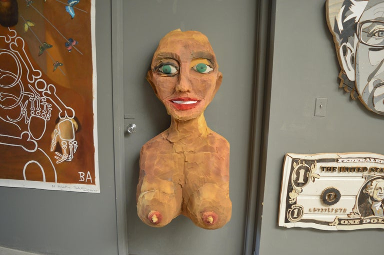 Giant foam hand sculpted bust, over 4 feet tall. Oversized proportions, interesting piece of folk art. Hand-painted. Some foam loss. Wall mounted.