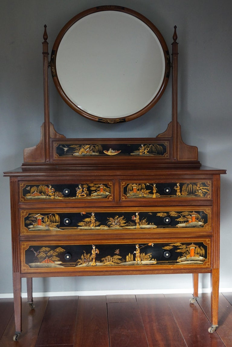 Stunning, practical and all hand-crafted chest of drawers with circular mirror.  This museum quality and condition piece of furniture and work of art at the same time, dates back to the era of the British Aesthetic Movement. It is part of a unique