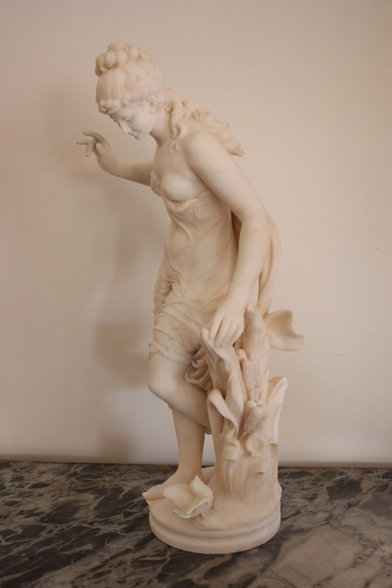 A 19th century marble sculpture by Italian artist Fausto Biggi, in carrara marble.  Beautiful figurative sculpture representing a draped woman with a bird on the base. The fingers has been restaured. Signed on the base. Dimensions: Height 77.5cm,