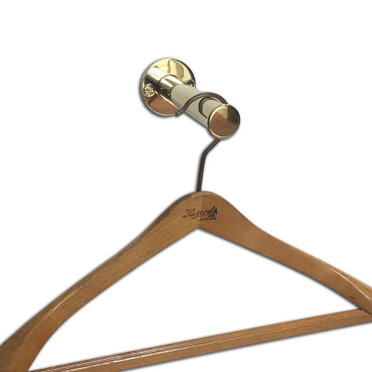 An Andrew Nebbett Designs Retactable Wall Mounted Valet Hook Ideal For Dressing Rooms Etc