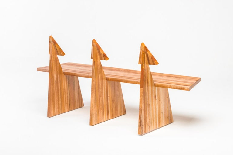 Designed by Juliana Lima Vasconcellos in 2018, the trio bench in made in solid African mahogany wood panels. This bench has a contemporary and simple image, inspired by pure geometric shapes and furniture of pre-modernist architects. The