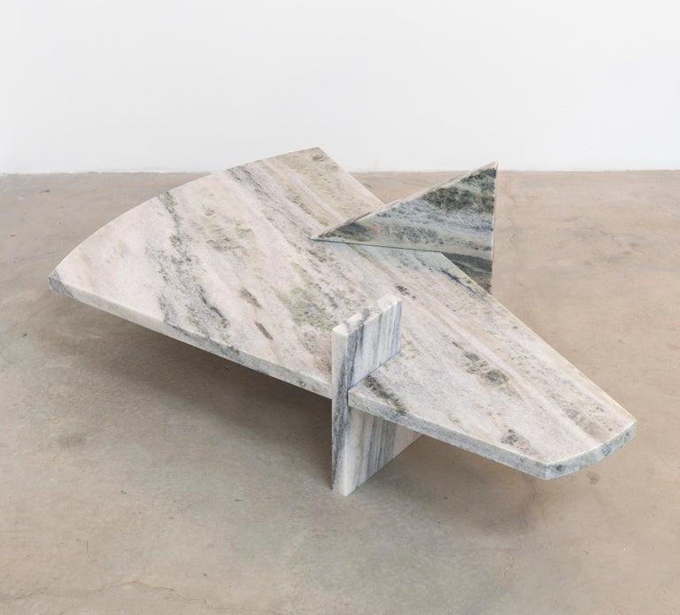 This coffee table is composed of three interlocking planes of granite. Each piece is designed with the same engineering as Japanese joinery, using stone as the sole material of construction.