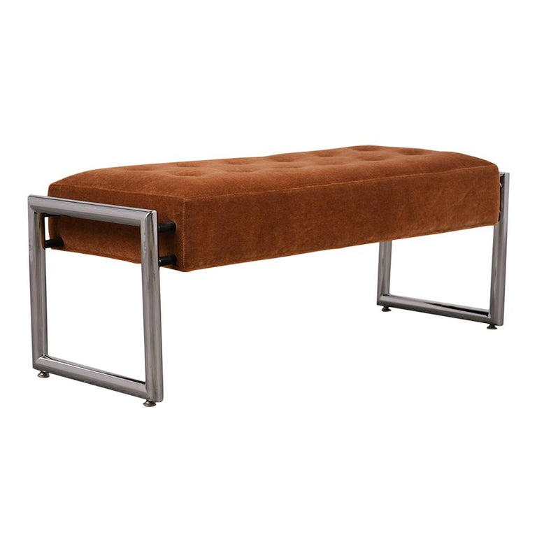 Modernish bench with tubular chrome legs. Seat has been professionally reupholstered in a burnt orange mohair fabric color, with square tufted design. Has top-stitch details. Solid and sturdy frame with comfortable seat. Ready for any home or office.