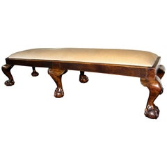 Long Carved Walnut Six Footed Ball and Claw Stool