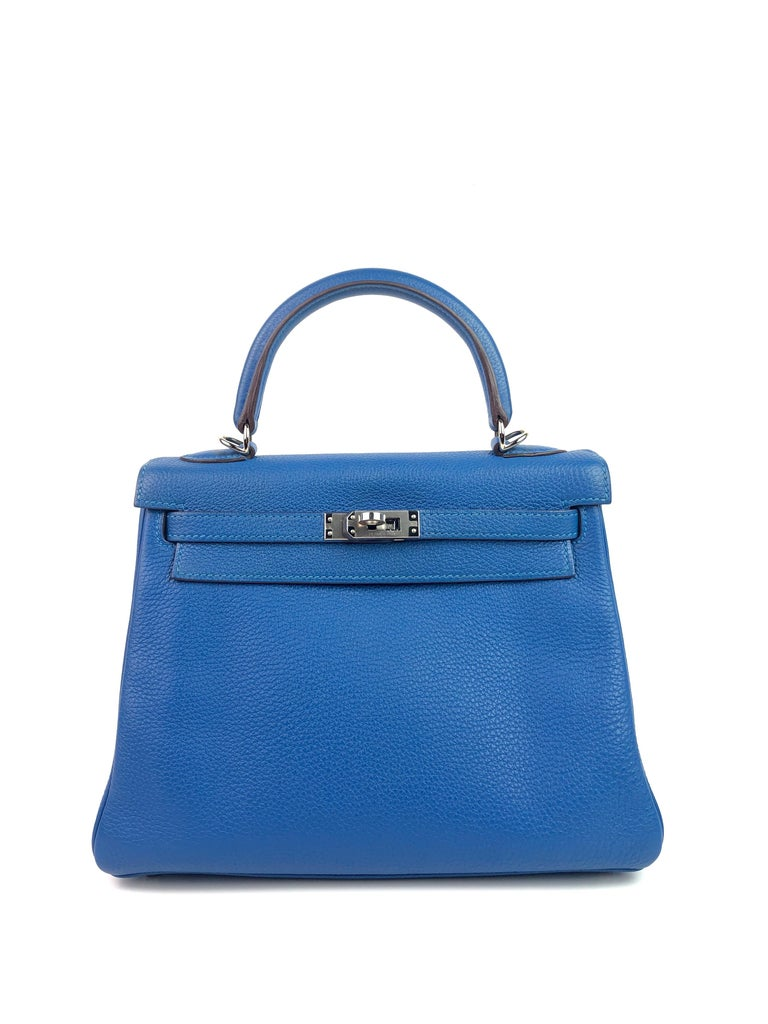 Hermes Kelly 25 Mykonos Blue Togo Palladium Hardware. Excellent Pristine Condition with Plastic on Hardware. Excellent corners and structure.  Shop with Confidence from Lux Addicts. Authenticity Guaranteed!