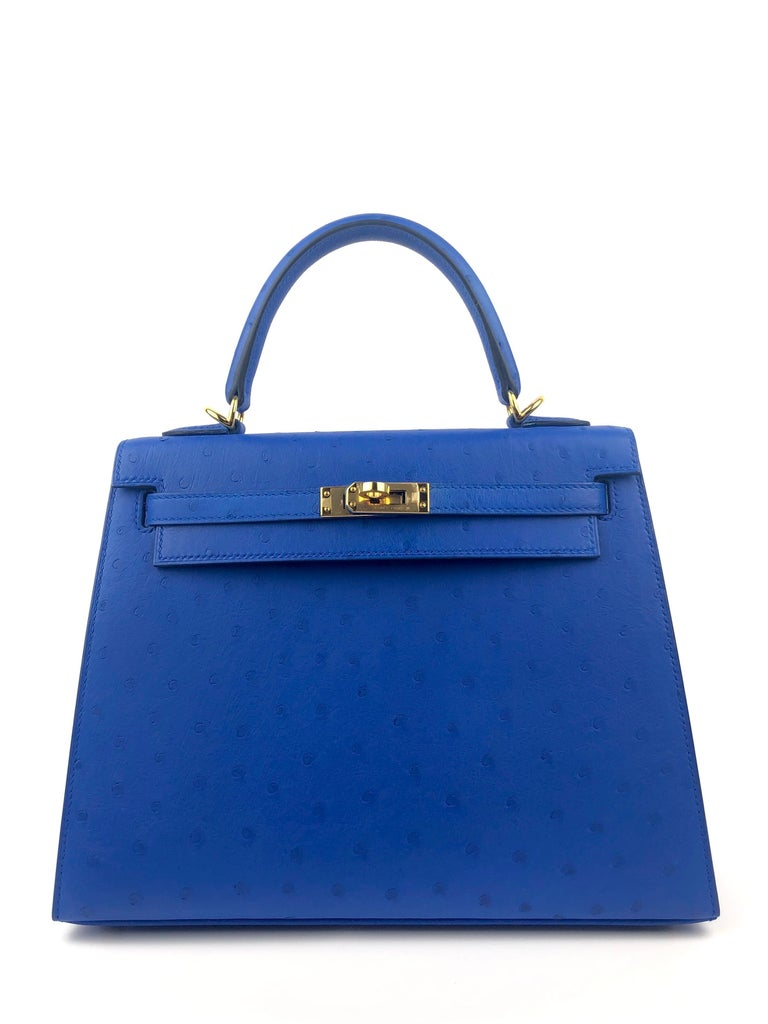 New Hermes Kelly 25 Ostrich Bleuet Blue Gold Hardware. New rare Bleuet Hermes color. From collectors closet! D Stamp 2019.   Shop with Confidence from Lux Addicts. Authenticity Guaranteed!
