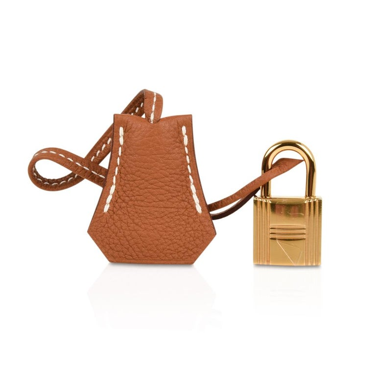 Guaranteed authentic Hermes Kelly 25 Retourne bga  features coveted classic Gold in togo leather. Lush with Gold hardware.    Comes with lock, keys, clochette, sleepers, raincoat and signature Hermes box. NEW or NEVER WORN. final sale  BAG