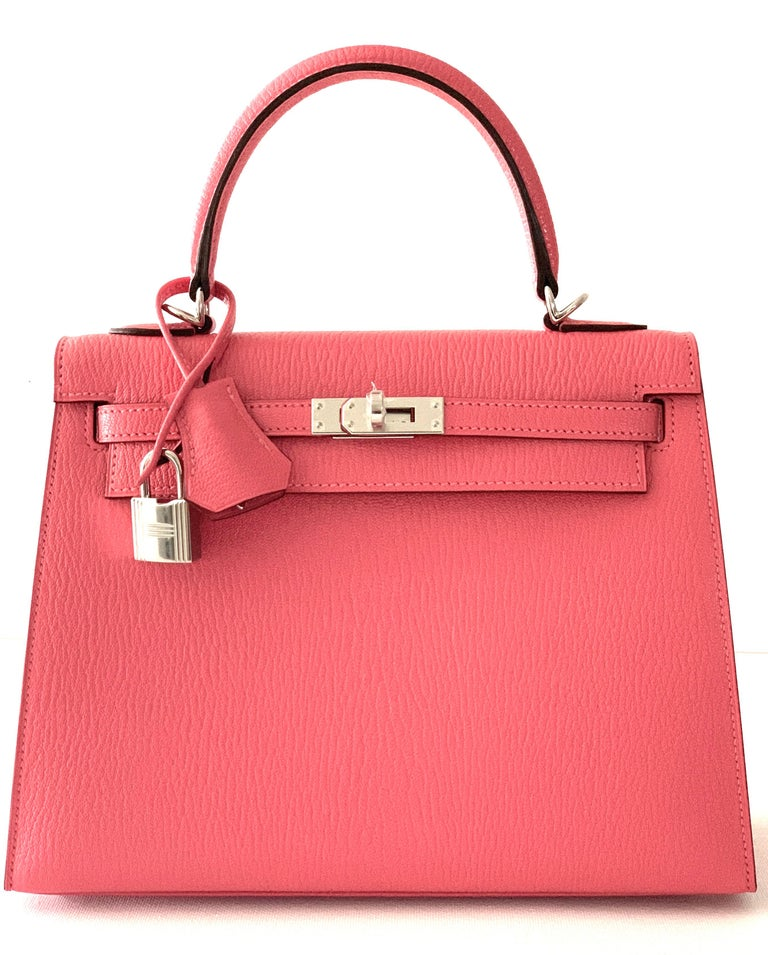 Hermes Kelly 25cm Rose Lipstick , very rare color, most sought after This is a true treasure You wont find this Condition: New unworn Very Rare Chevre Leather, one of the most durable leathers Hermes makes, which is why its so collected Palladium