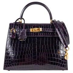 Hermes Kelly 25 Sellier Bag Crocodile Prunoir Gold Hardware Deep Plum Purple