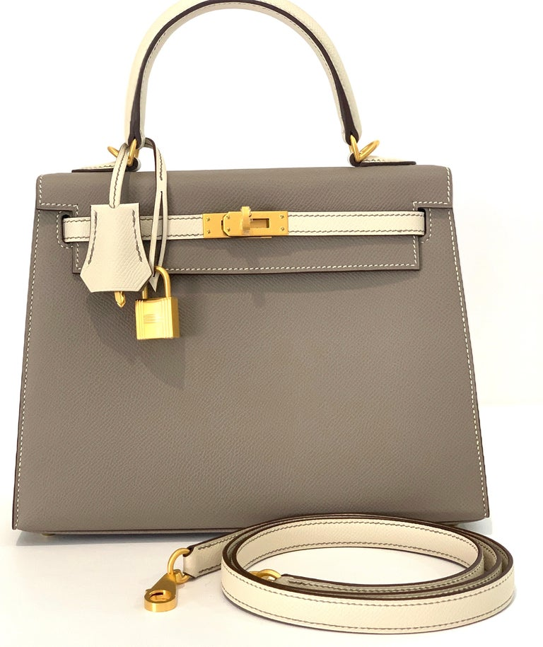 Hermes 25cm Kelly Hermes Kelly 25cm  Special order Gris Asphalte  and Craie Contrasting topstitching detail Brushed Gold Hardware A perfect neutral Kelly  Epsom sellier  Plastic on the hardware  Accompanied by: Hermes box, Hermes dustbag, clochette,