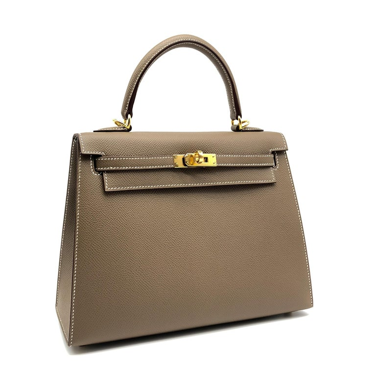 Brand: Hermès  Style: Kelly Sellier Size: 25cm Color: Etoupe Leather: Epsom Hardware: Gold Stamp: 2020 Y  Condition: Pristine, never carried: The item has never been carried and is in pristine condition complete with all accessories.  Accompanied