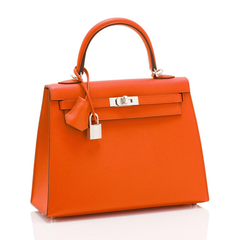 Hermes Kelly 25cm Orange Feu Epsom Sellier Bag Palladium  Brand New in Box. Store Fresh. Pristine Condition (with plastic on hardware). Perfect gift! Comes full set with keys, lock, clochette, shoulder strap, sleeper, rain protector, and Hermes
