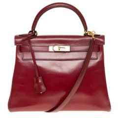 Hermes Kelly 28 cm strap in Burgundy box calf shoulder bag with gold hardware