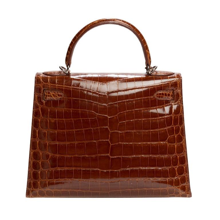 Brown Hermès Kelly 28 handbag with strap in crocodile