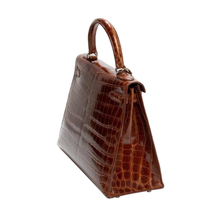 Women's Hermès Kelly 28 handbag with strap in crocodile
